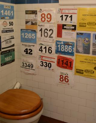 Race numbers are a playful touch in the downstairs toilet. Mr Gwynne-Jones competes in multisport...