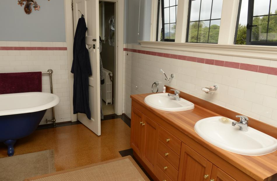 The ensuite was created from four small rooms. The bath and the pink tiles are both original.