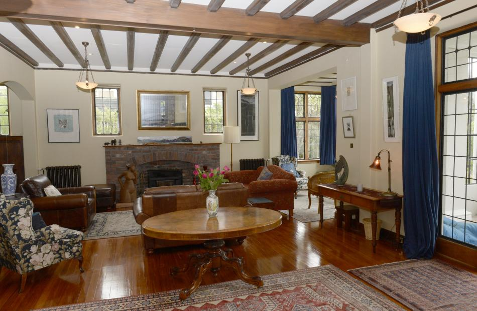 In the drawing room, the owners removed white from the brick fireplace and uncovered the two...