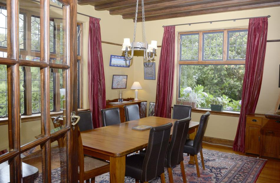 The dining room has a wood-panelled ceiling.