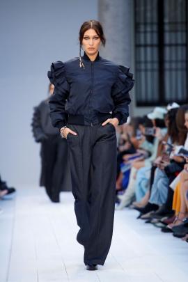 Model Bella Hadid in a ruffled billowy creation by Max Mara in Milan.
