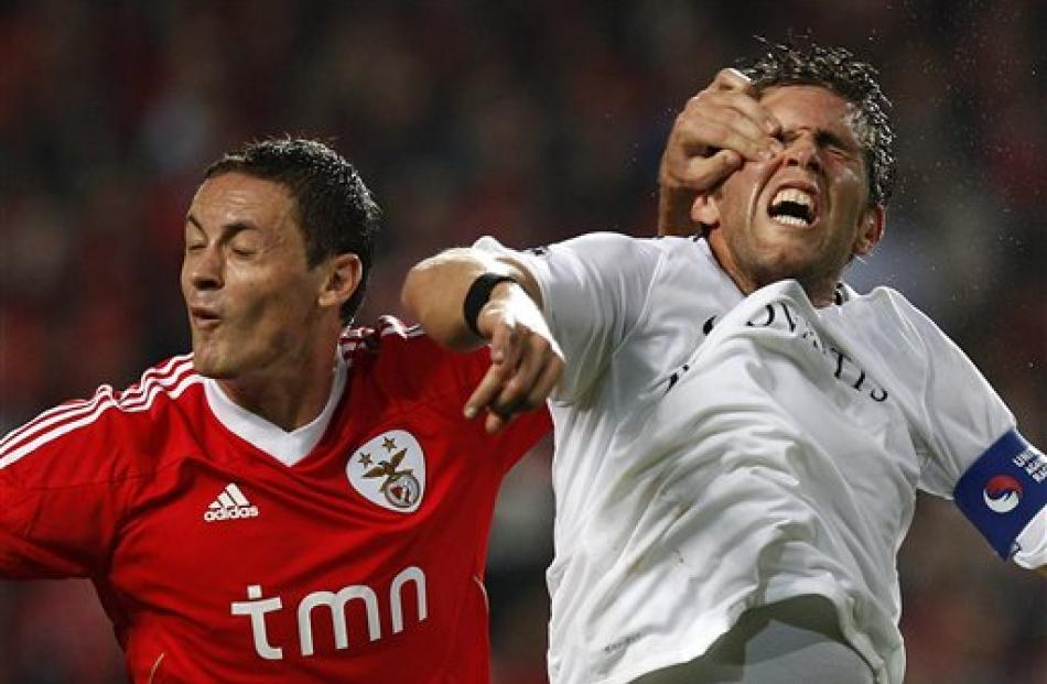 Benfica's Nemanja Matic, left, from Serbia, vies for a high ball with Basel's Benjamin Huggel...