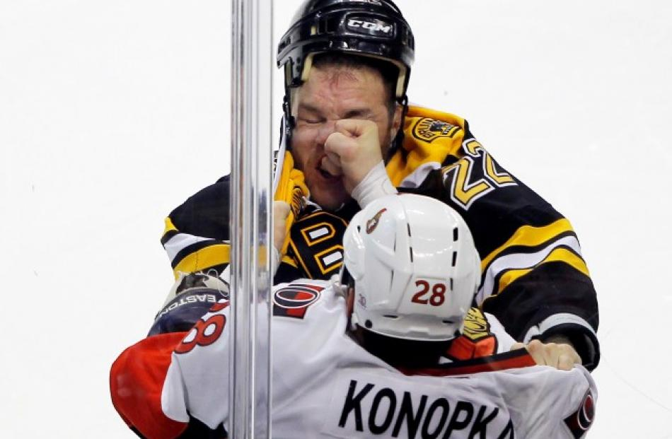 Boston Bruins right wing Shawn Thornton (top) and Ottawa Senators center Zenon Konopka fight in...