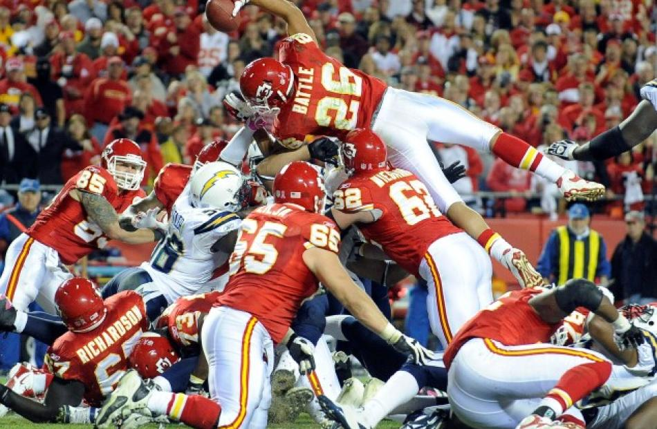 Kansas City Chiefs running back Jackie Battle dives over the pile for a touchdown against the San...