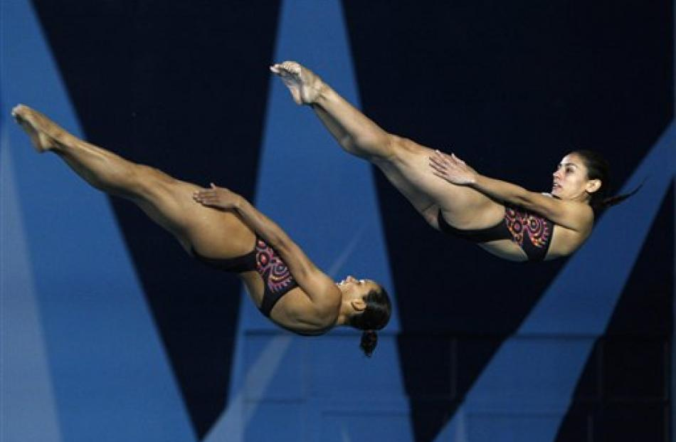 Mexico's Paola Espinoza, right, and Laura Sanchez compete in the women's synchronized 3m...