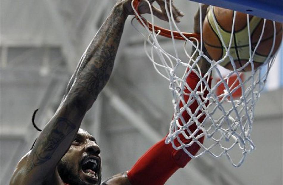 Puerto Rico's Renaldo Balkman dunks during the men's basketball match for the gold medal against...