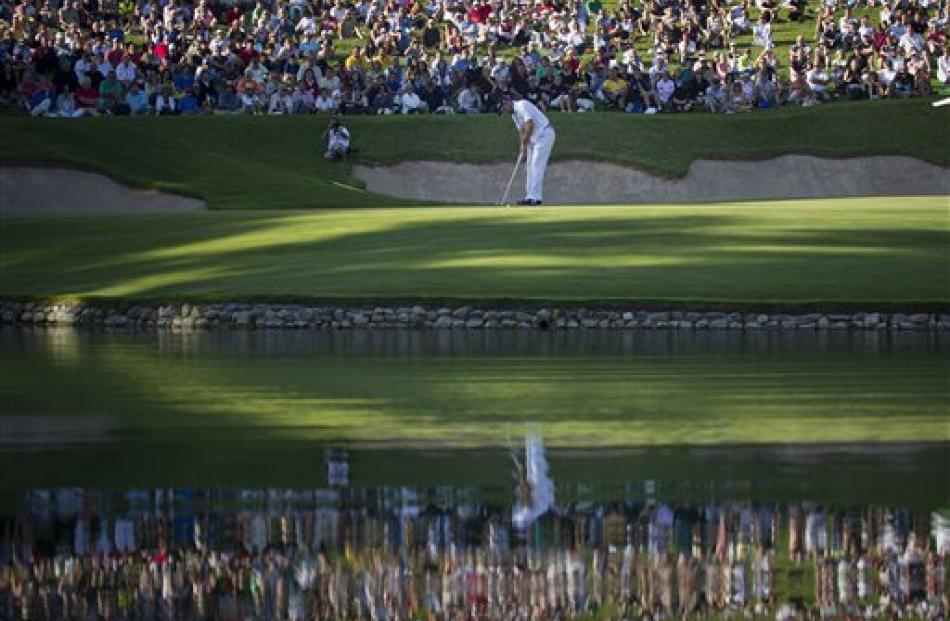 Sergio Garcia of Spain putts on the 17th hole during the final round of the Andalucia Masters at...