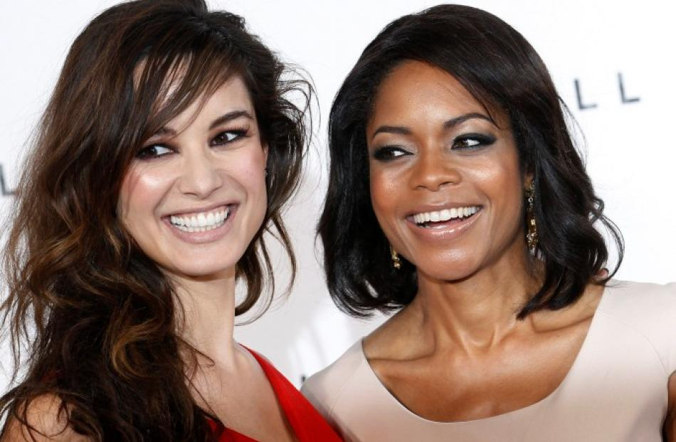 'Bond girls' Berenice Marlohe (L) and Naomie Harris pose 'SkyFall' production launch. REUTERS...