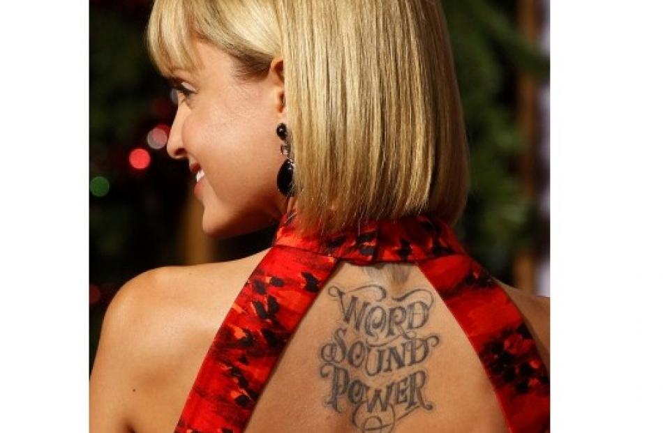 Actress Mena Suvari shows her tattooed back at the premiere of 'A Very Harold & Kumar 3D...