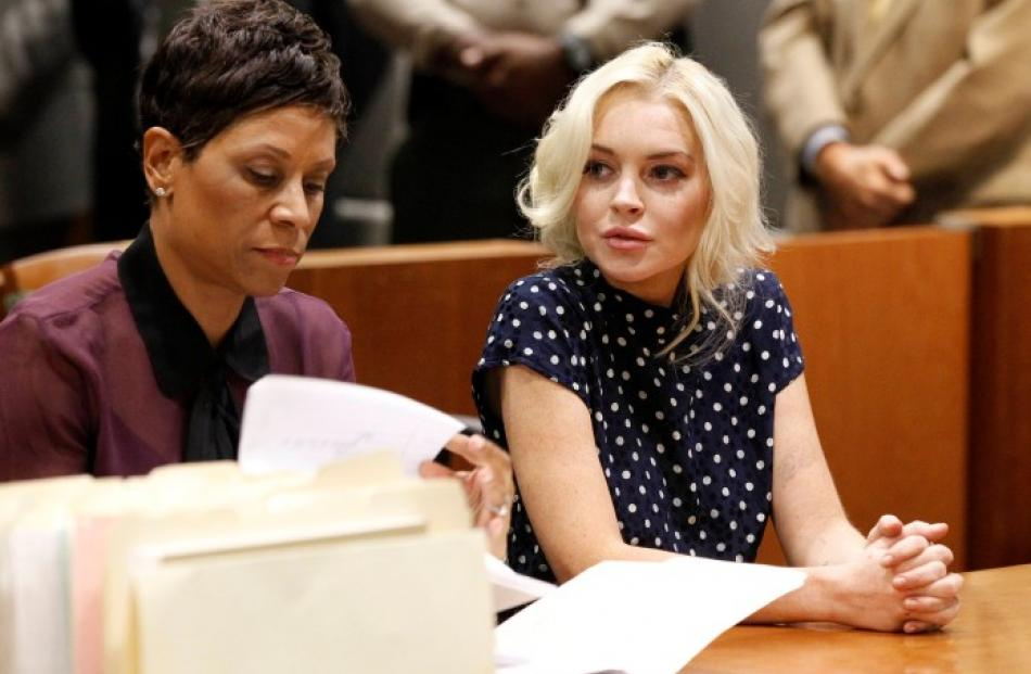 Lindsay Lohan (R), accompanied by her attorney, in court in Los Angeles, where a judge ordered...