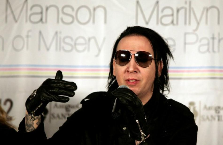 Musician Marilyn Manson speaks during a news conference about his art exhibit 'The Path of Misery...