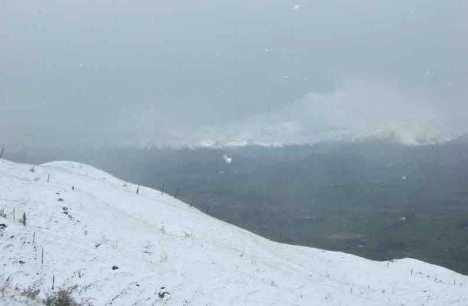 Conditions almost reach white-out levels on the Coronet Peak access road.