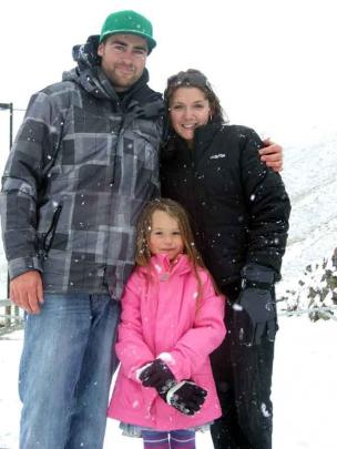 Ben Thatcher, of Queenstown, Emelia Thatcher (4) and Melissa Parker, both of Auckland, take a...