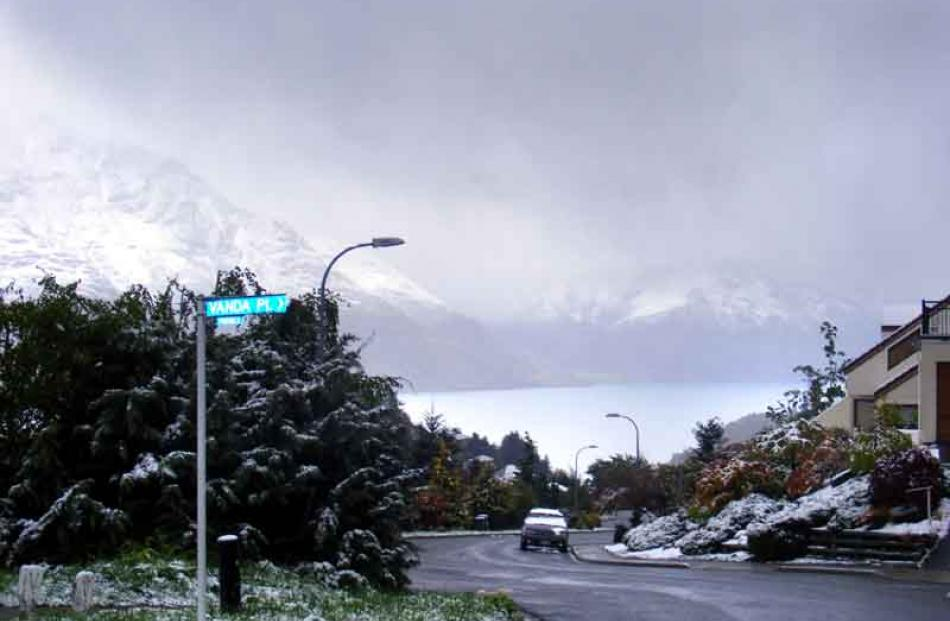 Snow continues to fall in the Queenstown suburb of Fernhill.