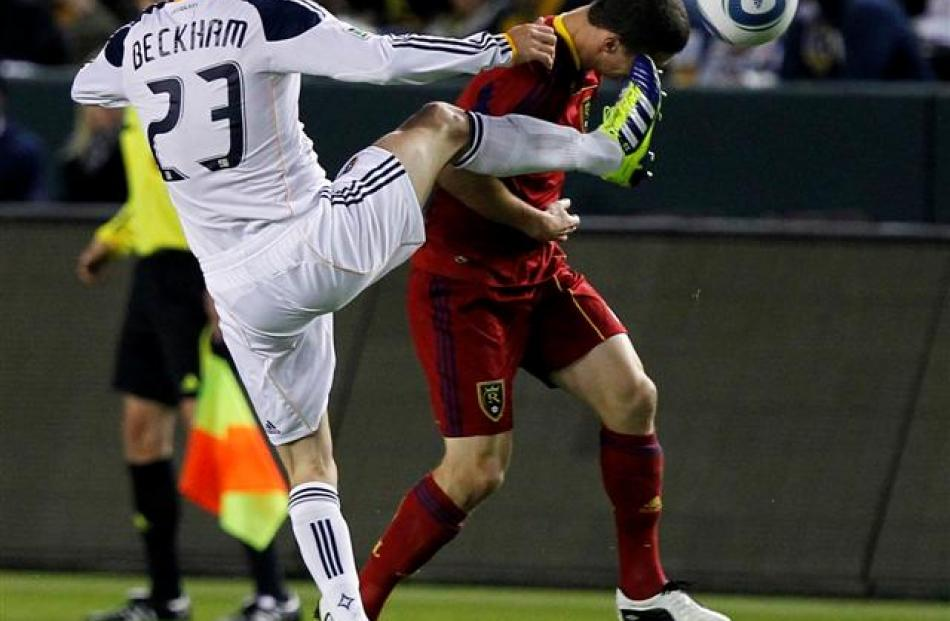 Los Angeles Galaxy midfielder David Beckham kicks Real Salt Lake midfielder Will Johnson in the...