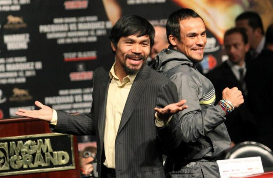 Filipino boxer Manny Pacquiao (L) and Mexican boxer Juan Manuel Marquez pose during a news...