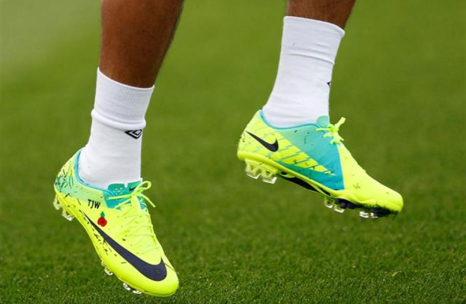 England's Theo Walcott wears a poppy on his boots during a training session in London Colney,...