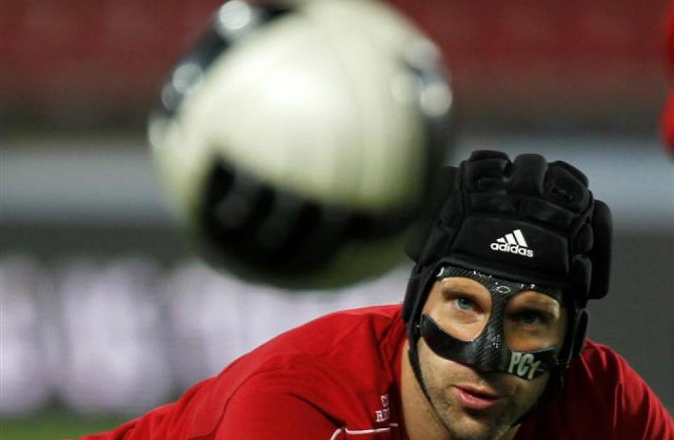 Czech national soccer team player Petr Cech watches a ball during a practice session in Prague....
