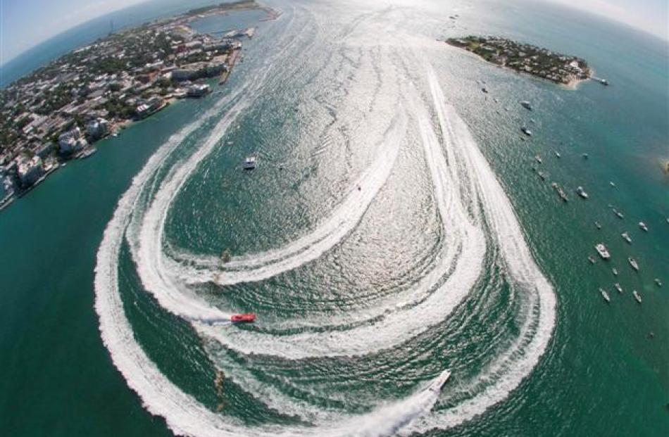 Offshore powerboats make the turn in Key West Harbour during the first of three race days at the...
