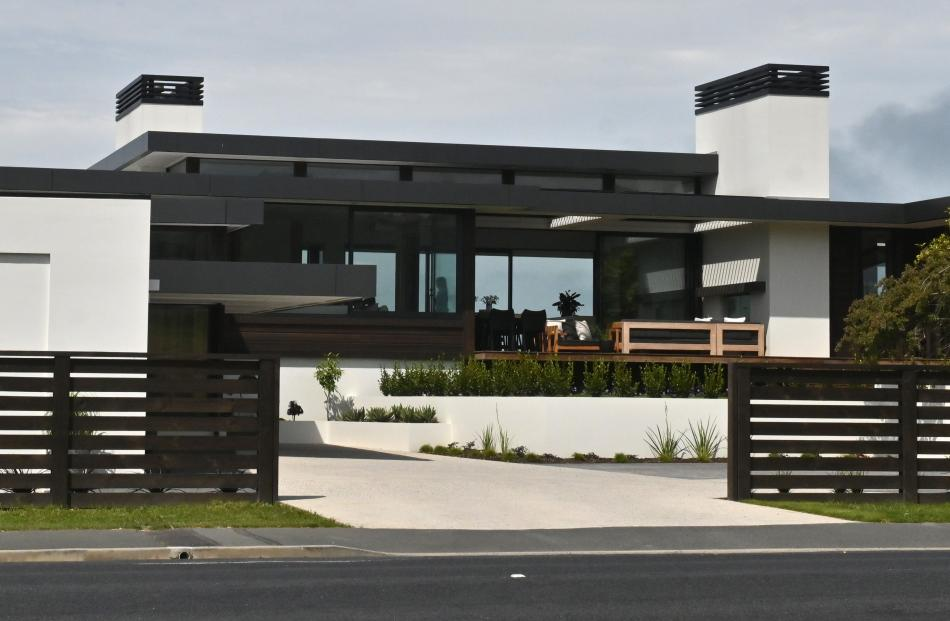 Long, low horizontal layers of roof-line mirror the ocean horizon of this Ocean View home, a...