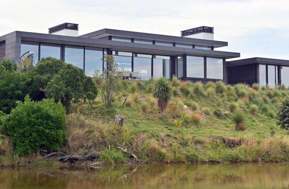The house looks over Taylor's Creek to the beach. The couple have planted tussocks here and each...