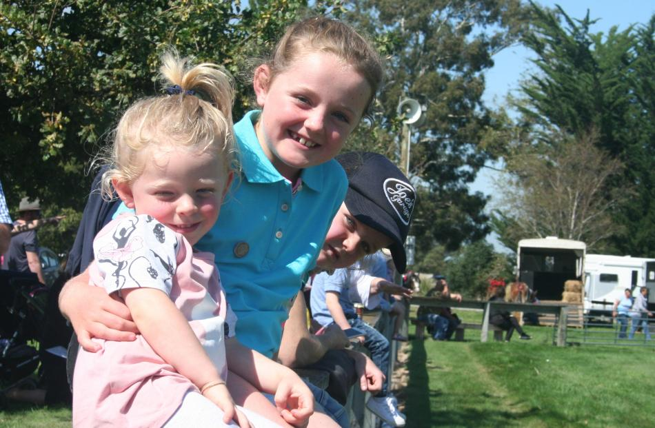 Maisey Dunlea (2), Tilly Taylor (8) and Maggie Taylor (4) watch the action in the main ring at...