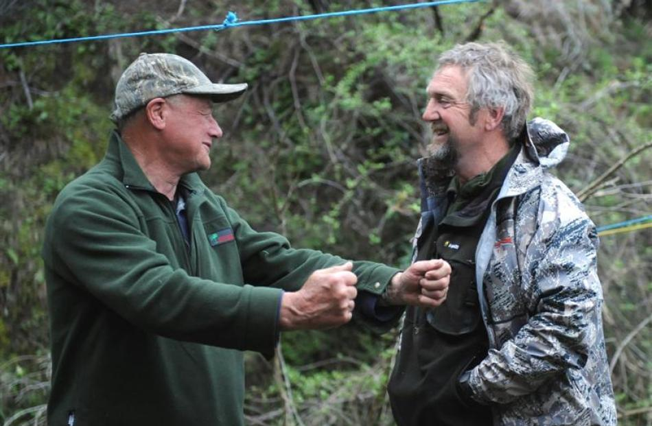 Bill O'Leary and Gerald Telfor chew the fat at base camp.