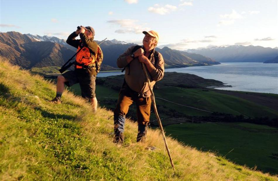 With the sun not yet reaching the valley floor, Wal Shuttleworth (left) and Alan McKay search for...