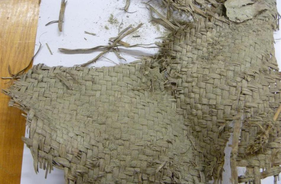 Woven flax, thought to be a food bag or sleeping mat, removed from the Roxburgh Gorge.
