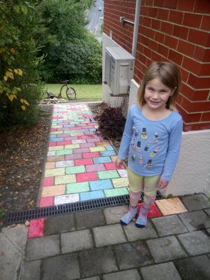 Emily Harris (6) with her chalked path made on Sunday. PHOTO: KATIE BURNS