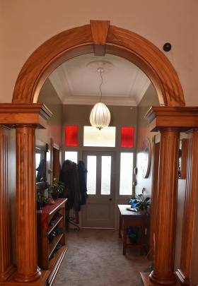 Dark shellac varnish was removed from the arch in the hall and the chandelier was commissioned...