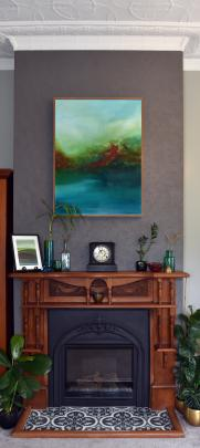 The owners managed to retain the black, arch-shaped fire surround in the living area by having...