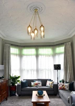 The pressed metal ceilings were one of the features that attracted the owners to the house. The...
