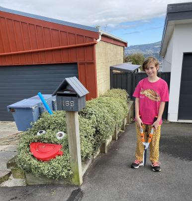 Chelsea Mitchell (10) created The Very Hungry Caterpillar this week outside her home in Waverley....