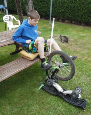 Levi Millar (12) of Outram, gets creative in the garage to pass the time. He used an old broken...