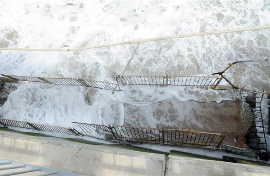 A section of a St Clair seawall ramp that has fallen into the surf below. Photo by Craig Baxter.