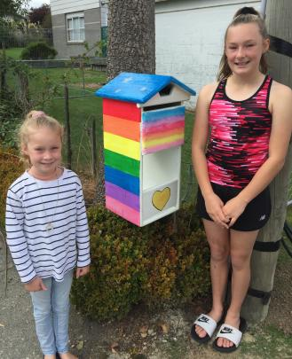 Alice (6) and Olivia (10) Pennell, of Balclutha, with their newly painted letterbox. PHOTO: SALLY...