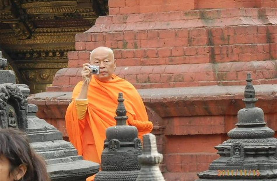 A 'tourist monk' in Kathmandu.