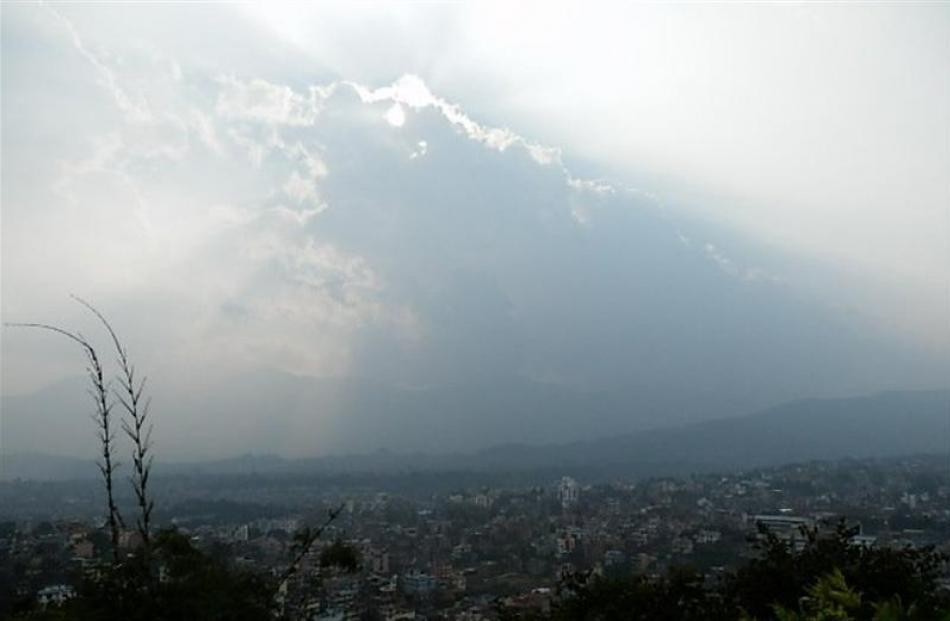 The sun struggles to break through clouds in Kathmandu.