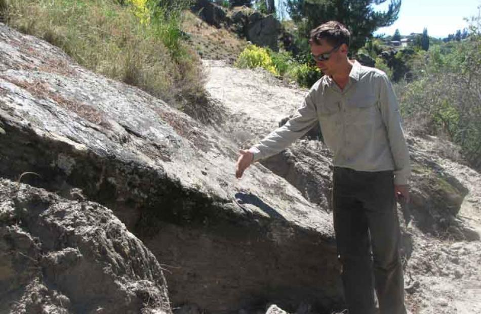 Mr Dennis discusses how the trust will deal with a rock in the way of the trail, indicating where...