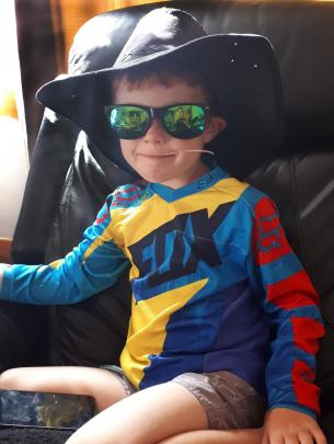 Kobey McGuire (5) plays dress-up at his home in Mosgiel. PHOTO: KENDALL MCGUIRE
