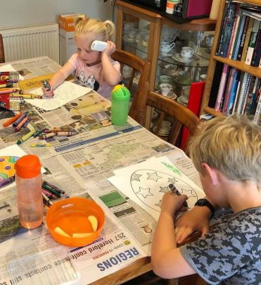 Carry on colouring in . . . Sophie (2) and Eli (7) Harradine colour in at the dining room table...