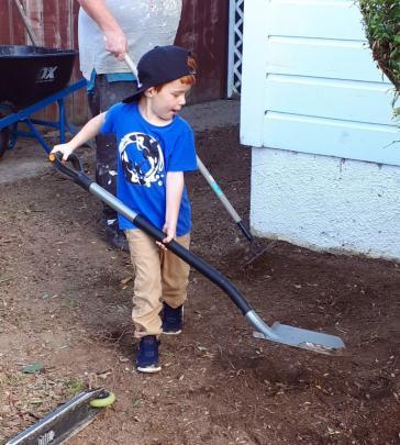Daddy's little helper ... Kobey McGuire (5) helps Dad, Jamie, with the garden in Mosgiel. PHOTO:...