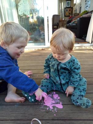 Thixotropic . . . Isaac (3) and Ruth (8 months) Mountfort investigate homemade slime (made from...