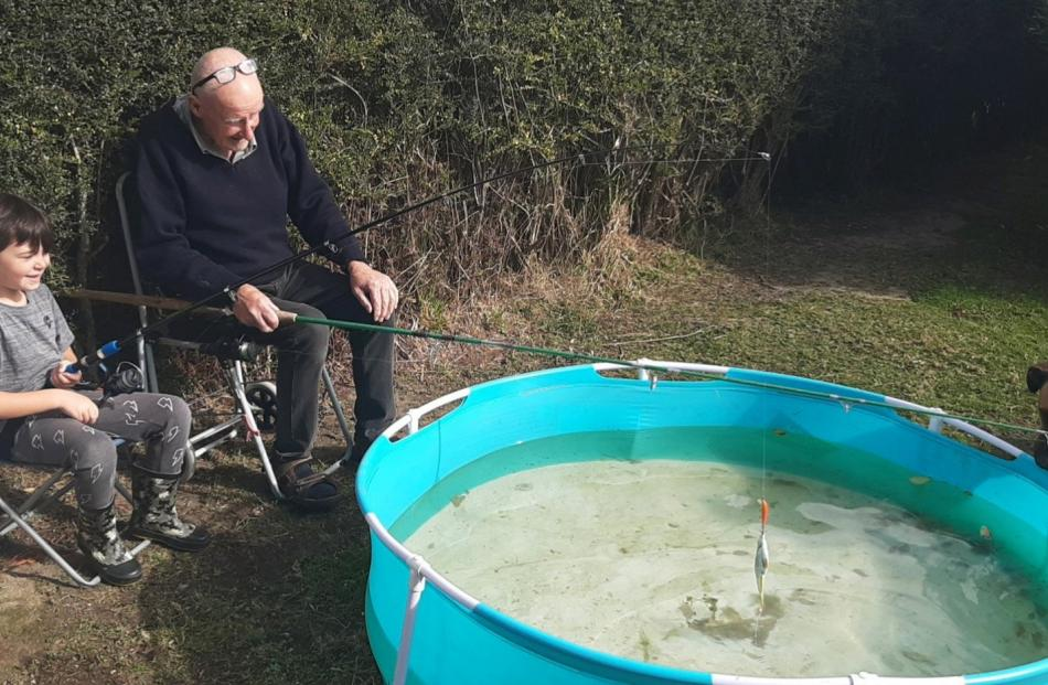 "Any luck? ""Fishing"" in the backyard are Kingston Boyes (6) and his Grandad Tony Webb. PHOTO:..."