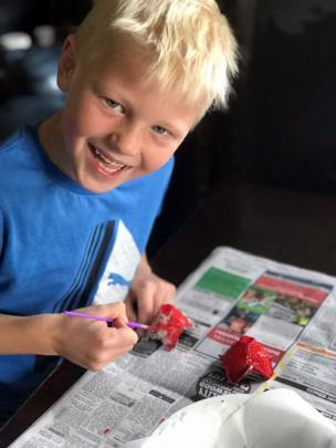 Creative endeavour . . . Max Smith (7) makes and paints poppies from egg cartons at home in...