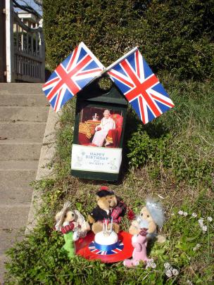 Loyal subjects . . . A Teddy Bears' picnic to honour the Queens 94th birthday today in South Hill...