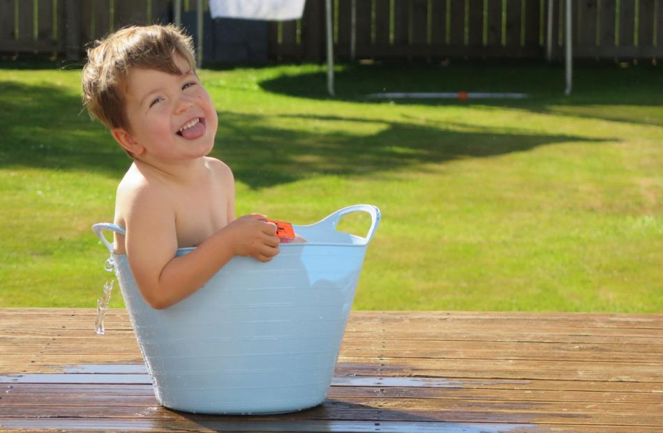 Brodie Donaldson (2), of Mosgiel, in a backyard bath. PHOTO: CLAIRE RUTHVEN