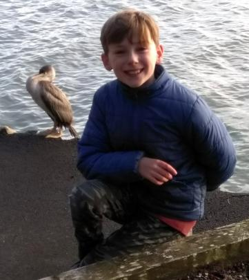 Liam Davis (10), of Waverley, meets a friendly cormorant on his bubble walk beside the Vauxhall...