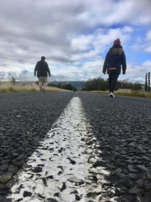 Parker (16) and Alyssia Urquhart-Eaton enjoy a walk along a quiet road near Momona. PHOTO: LAURYN...